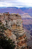 People near the edges of Grand Canyon. Stock Photos
