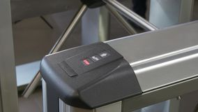 People near electronic turnstile wicket checkpoint in office. Modern equipment of access system in business center closeup. Macro video. Successful employees stock footage