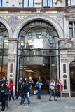 People near Entrance to Apple store in London Stock Photo