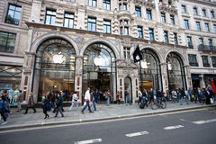 People near Entrance to Apple store in Regent Stre Stock Image