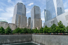 People near Freedom Tower and 9/11 Memorial royalty free stock photography