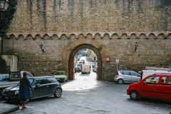 People near gate Porta San Miniato in Florence Stock Photos