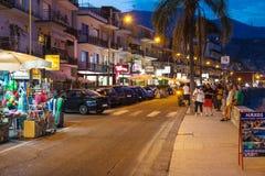 People near gift shops in Giardini Naxos in night Stock Photos