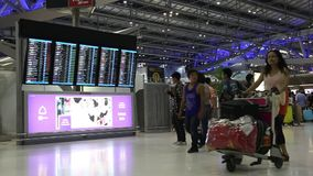 People near information board in Bangkok international airport, Thailand stock video