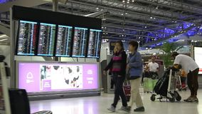 People near information board in international airport in Bangkok, Thailand stock video footage