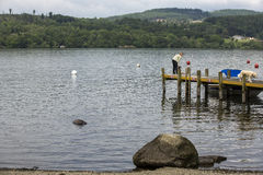 People near a lake in England. Stock Photos