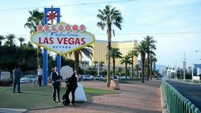People near Las Vegas sign, Las Vegas Strip, Las Vegas, USA, stock video footage