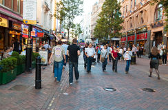 People near Leicester Square in London Royalty Free Stock Image