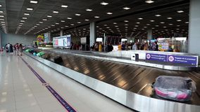 People near luggage claim in international airport in Bangkok, Thailand Stock Photography