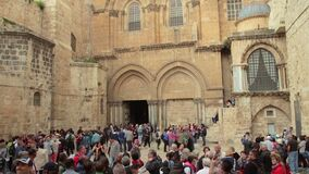 People near the main entrance in at the Church of the Holy Sepulchre in Old City of Jerusalem