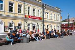 People near McDonald's restaurant building Royalty Free Stock Photo