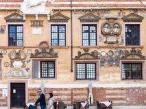 People near medieval Palazzo della Ragione Stock Photography