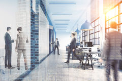 People near a meeting room. Rear view of people near a meeting room of an office with a reception counter. 3d rendering. Toned image. Double exposure Royalty Free Stock Images