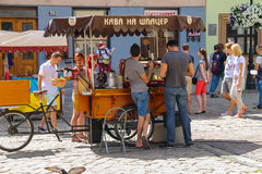 People near mobile coffee shop in historic city center. Lviv, Stock Images