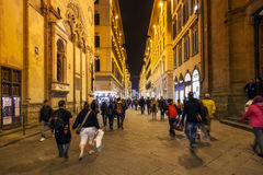 People near Orsanmichele church in night stock images