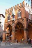 People near Palazzo della Mercanzia in Bologna. Italy royalty free stock photo