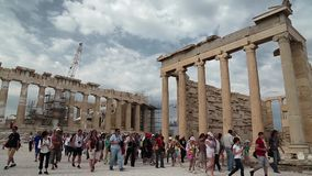 People near Parthenon - ancient temple in Athenian Acropolis, Greece stock video footage