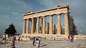 People near Parthenon - ancient temple in Athenian Acropolis, Greece stock video