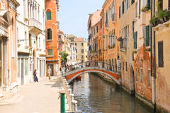 People near picturesque bridge over a narrow canal in Venice, It Royalty Free Stock Photos