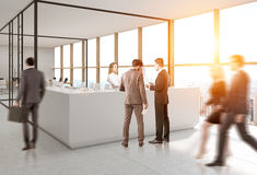 People near reception, glass open office Stock Image
