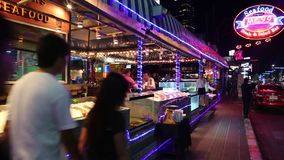 People near seafood restaurant in Pattaya, Thailand stock video footage