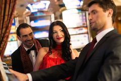 People near slot machine Royalty Free Stock Photography