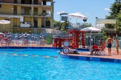 People near sweeming pools of Piscina Barracuda, San Cesario Sul Panaro, Italy royalty free stock photo