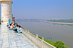 People near Taj Mahal and view on Yamuna River from Taj Mahal in Agra. India Royalty Free Stock Photo