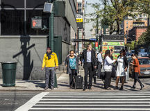 People near Wall street in Manhattan cross the street at white t Stock Photography