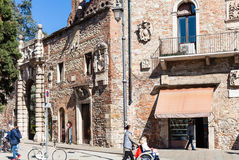 People near walls of gate to Teatro Olimpico. VICENZA, ITALY - MARCH 28, 2017: people near walls of gate to Teatro Olimpico in Vicenza city in spring. The city Stock Photography
