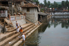 People near the water tank in ancient indian city Royalty Free Stock Image