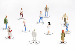 People networking. Group of people figurines standing with circles around them, concept for social network Stock Image