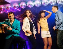 People at night club. Group of happy young people dancing at night club Royalty Free Stock Image
