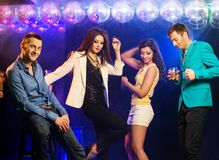 People at night club. Group of happy young people dancing at night club Stock Image