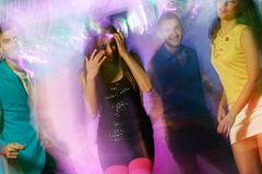 People at night club. Group of happy young people dancing at night club Royalty Free Stock Photos