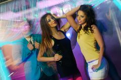 People at night club. Group of happy young people dancing at night club Royalty Free Stock Images