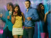 People at night club. Group of happy young people dancing at night club Stock Photo