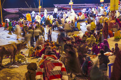 People in the night in Varanasi. VARANASI - INDIA, DECEMBER 10: Hindu people wash themselves in the river Ganga in the holy city of Varanasi. The holy ritual of Royalty Free Stock Photography