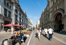People in Nikolskaya street have rest and some ice-cream Stock Images
