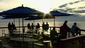People at ocean cafe sunset 1 stock footage