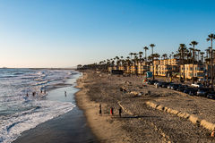 People on Oceanside Beach in San Diego County. OCEANSIDE, CALIFORNIA - MARCH 23, 2017: People participate in leisure activities on the popular Southern royalty free stock photography