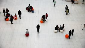 People in Oculus in New York transportation hub in New York. New York City, USA - June 20, 2018: Slow motion footage of high angle view of people waiting in stock video