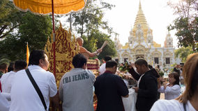 people offering food and items to a buddhist monk and being bles Royalty Free Stock Image
