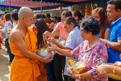 People offering sticky rice to monks in the morning Royalty Free Stock Photography