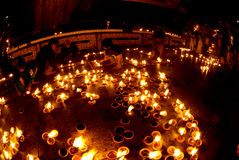 People offerings of candles for Kyaiktiyo Pagoda.Myanmar. Royalty Free Stock Photo