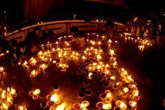 People offerings of candles for Kyaiktiyo Pagoda.Myanmar. Royalty Free Stock Photo