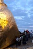 People offerings of gold for Kyaiktiyo Pagoda.Myanmar. Royalty Free Stock Photo