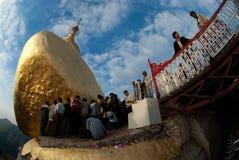 People offerings of gold for Kyaiktiyo Pagoda.Myanmar. Royalty Free Stock Image