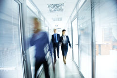 People in office. Business people walking in the office corridor Royalty Free Stock Photo