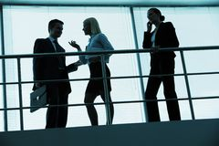 People in office. Three outlines of business partners interacting in office stock photos